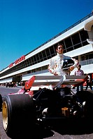 Jacky Ickx at French Grand Prix. The Belgian racing car driver Jacky Ickx (Jacques Bernard Ickx) beside a Ferrari 312 B2 waiting the beginning of the ...