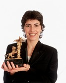 Giorgia won Sanremo Music Festival. Italian singer-songwriter Giorgia (Giorgia Todrani) showing the first prize won at 45th Sanremo Music Festival. Sa...