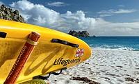Lifeguard surfboard at Porthcurno Beach. Cornwall, England.