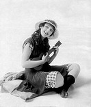 Carmel Myers Playing Ukulele, circa 1920s