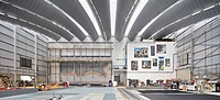 Royal Opera House Production Workshop, Purfleet, United Kingdom. Architect: Nicholas Hare Architects LLP, 2013. Panoramic view of production hall in u...