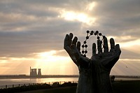 "The Disused Richborough Power Station beyond the Ramsgate based """"Hands and Molecules"""" Sculpture, Kent, England."