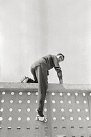 Livio Berruti on a wall. Italian sprinter Livio Berruti climbing a wall at the Rome Olympic Games. Rome, 1960