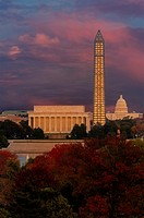 A view from across the Patomac River to the Lincoln Memorial, the Washington Monument and the Capitol Building during autumn and sunset. The peak fall...
