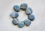 Pebbles with veins and lines forming a circle