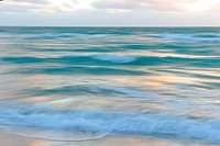 Ocean at sunrise, abstract shot with panning.