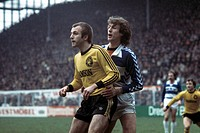 football, Bundesliga, 1976/1977, Westfalen Stadium, Borussia Dortmund versus MSV Duisburg 2:1, scene of the match, Hans-Werner Hartl (BVB) left and Ke...