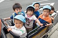 Children in daycare buggy in Tokyo, Japan.