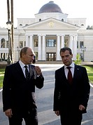 Moscow region, russia, october 1, 2010, president of russia dmitry medvedev (r) and prime minister vladimir putin chat during a walk at gorki residenc...