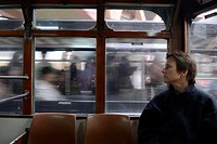 Hong Kong, China, Asia. European woman travelling in tram on Hong Kong Island.