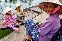 Local Women Wait For Tourists To Take Out On River Boat Trips, Hoi An, Quang Nam Province, Vietnam.