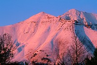 Mears Peak at sunset with fresh autumn snowfall, Uncompahgre National Forest, Colorado, USA.