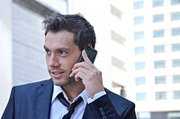 Businessman talking on mobile phone.