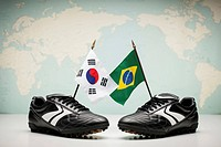 two pairs of football shoes with a Brazilian and a Korean flag