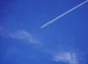 Long range passenger airliner contrailing