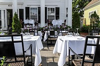 Tables set for outdoor dining at Ristorante Marissa in Provincetown, Massachusetts, USA.