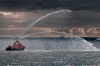 small fireboat demonstrating its capabilities on Baltic Sea in Gdansk, Poland.