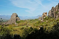 Sandstone rock pillars in Meteora with the Holy Monastery of St. Nicholas Anapausas on the right, Kastraki, Greece.