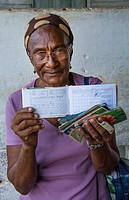 Trinidad Cuba woman with ration book for rations for food supplies in Cuba with very little food for people for one month welfare 13.