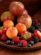 Pile of Fresh Ripe Fruit Apples Strawberries Blueberries Blackberries Raspberries and Apricots
