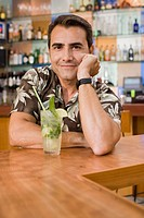Man Having Drinks at Bar
