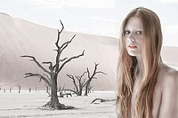 Woman in a desolate land.