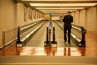 Man on a moving walkway.