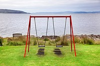 swing on seaside play equipment in Arran Island. Scotland.