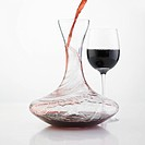 wine being poured into a carafe
