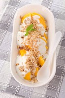 mango with cereals and yogurt