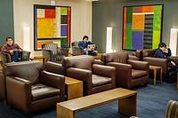 New York, New York, John F. Kennedy International Airport, JFK, terminal, concourse, gate area, American Airlines Ambassador Lounge, seating, Asian, m...