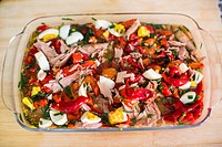 Pimientos asaos or typical Andalusian roasted red pepper salad with tuna, black olives, hard-boiled egg and chive, dressed with sherry wine vinegar an...