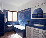 Bright blue tiles in modern Spanish bathroom