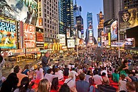 New York, city, people sitting on bleachers in the middle of Times Square in New York City.