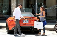 Jesse Metcalfe and Cara Santana shopping on Melrose and driving in a 2014 Jaguar F Type Convertible Featuring: Jesse Metcalfe,Cara Santana Where: Los ...