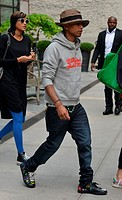 Pharrell, wearing a new hat style, spotted leaving his Manhattan hotel with his wife Helen Featuring: Pharrell,Helen Lasichanh Where: Manhattan, New Y...
