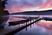 Jetty and Boats at Dawn Coniston Water near Coniston Lake District Cumbria England.