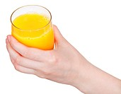 glass with orange juice in hand isolated