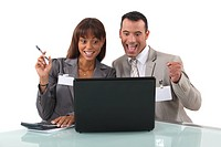 elated business duo with laptop