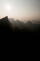 Foggy mountain sunset scenery at Tianmen Mountain National Park, Zhangjiajie, Hunan, China