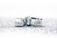 Gift boxes on glitter silver background with white copy space