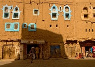 Shops In An Adobe Building With Blue Painted Windows, Amran, Yemen