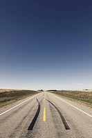 View of empty road with skidmark and landscape on Highway 15, Saskatchewan, Canada