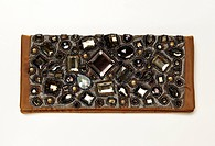 Close-up of clutch with stones on white background