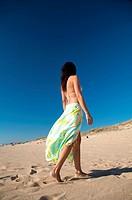 woman with beach wrap at el palmar beach in cadiz spain