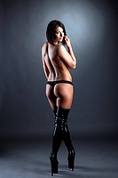 Sexy slim woman posing in black jackboots