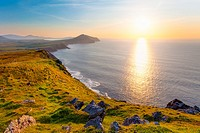 sunset over atlantic with coastline of western ireland, dingle peninsula,exposures enfused for wider tonal range.