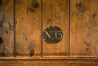 Number 13 on wood panelling.