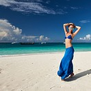 Woman in skirt at tropical beach