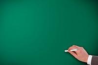 hand writing on empty green chalk board